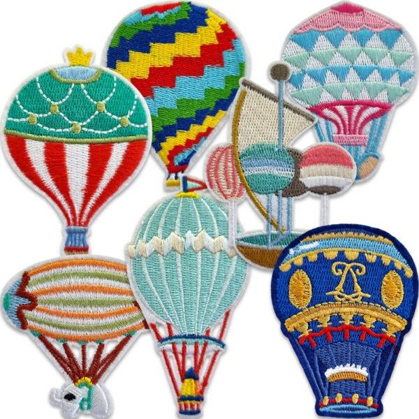 tygmärken färgglada luftballonger