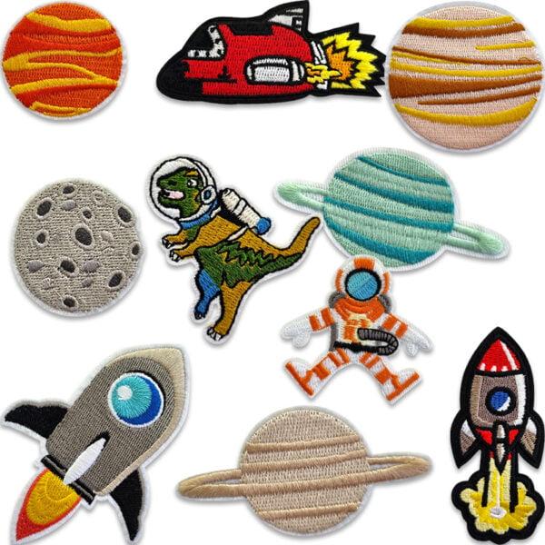 Rymdmotiv tygmärken - planeter, raketer och astronauter